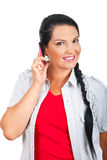 Happy woman talking by cell phone royalty free stock image