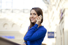 Happy woman talking on cell phone Royalty Free Stock Photography