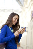 Happy woman talking on cell phone Stock Photo