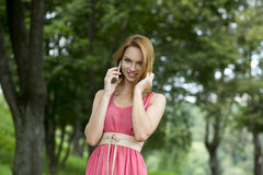 Happy woman talking on cell phone Royalty Free Stock Photo