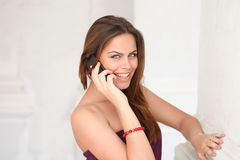 Happy woman talking on cell phone Royalty Free Stock Image