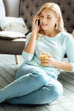 Happy woman talking on a cellphone Stock Photo