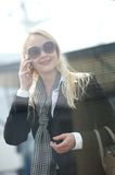 Happy woman talking on cellphone outside Royalty Free Stock Images