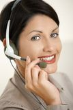 Happy woman talking on headset Stock Image