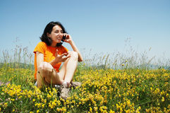 Happy woman talking on her cell phone Stock Photos