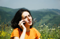 Happy woman talking on her cell phone Royalty Free Stock Photography