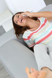 Happy woman talking and laughing on smarphone Royalty Free Stock Photo