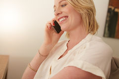 Happy woman talking on mobile phone Stock Photography