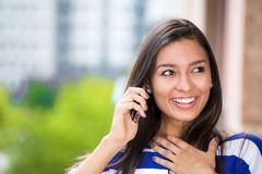 Happy woman talking on mobile phone outdoors city urban background royalty free stock photography