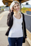 Happy Woman Talking On Mobile Phone At Railroad Platform Stock Photography