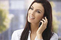 Happy woman on mobilephone. Happy woman talking on mobilephone, smiling outdoors Stock Photos