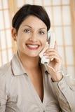Happy woman talking on phone Stock Photo