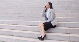 Happy woman talking on phone Stock Photos