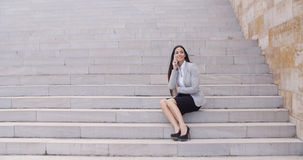 Happy woman talking on phone Royalty Free Stock Image