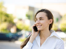 Happy woman talking on a phone. Closeup portrait, headshot happy beautiful woman laughing, speaking on cell phone, isolated outdoors background office park trees Royalty Free Stock Photo
