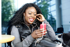 Happy Woman Talking Through Phone and Headphone Stock Images
