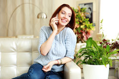 Happy woman talking on the phone and looking away Royalty Free Stock Photography