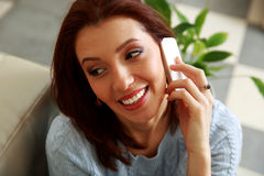 Happy woman talking on the phone and looking away Royalty Free Stock Image