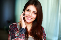 Happy woman talking on the phone Stock Images