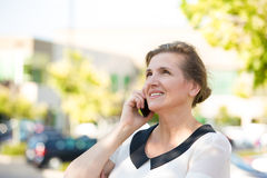 Happy Woman Talking on a Phone Stock Photo