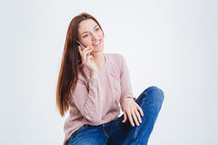 Happy woman talking on the phone Stock Image