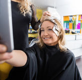Happy Woman Talking Selfie In Beauty Salon Royalty Free Stock Photography