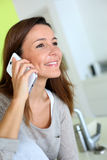 Happy woman talking on smartphone Royalty Free Stock Photo