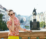 Happy woman talking smartphone at Wenceslas Square in Prague Royalty Free Stock Photos