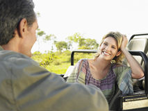Happy Woman Talking To Man By Jeep Royalty Free Stock Photo
