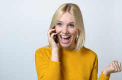 Happy Woman Talking to Someone Over the Phone Stock Photo