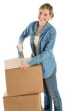 Happy Woman Taping Cardboard Boxes Stock Images