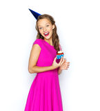Happy woman or teen girl with birthday cupcake Royalty Free Stock Photo