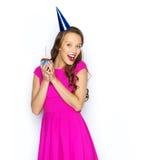 Happy woman or teen girl with birthday cupcake Stock Photos