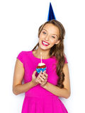Happy woman or teen girl with birthday cupcake Royalty Free Stock Photos