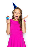 Happy woman or teen girl with birthday cupcake Stock Photos