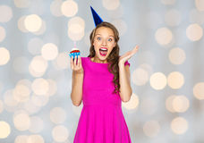 Happy woman or teen girl with birthday cupcake Stock Image