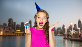 Happy woman or teen girl with birthday cupcake Stock Images
