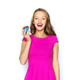 Happy woman or teen girl with birthday cupcake Royalty Free Stock Image