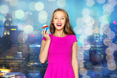 Happy woman or teen girl with birthday cupcake Royalty Free Stock Images