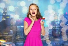 Happy woman or teen girl with birthday cupcake Stock Photo