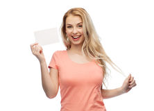 Happy woman or teen girl with blank white paper Royalty Free Stock Photos