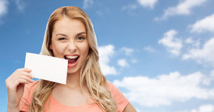 Happy woman or teen girl with blank white paper Royalty Free Stock Image