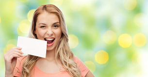 Happy woman or teen girl with blank white paper Royalty Free Stock Photography