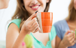 Happy woman or teen girl drinking tea from cup Stock Photo