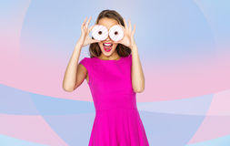 Happy woman or teen girl looking through donuts Royalty Free Stock Image