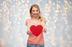 Happy woman or teen girl with red heart shape Stock Image