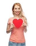 Happy woman or teen girl with red heart shape Royalty Free Stock Photos