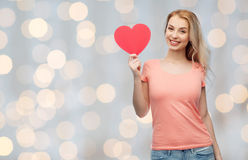 Happy woman or teen girl with red heart shape Royalty Free Stock Images