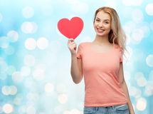 Happy woman or teen girl with red heart shape Royalty Free Stock Photo