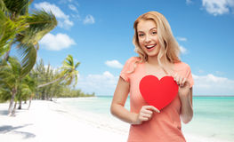 Happy woman or teen girl with red heart shape Stock Images